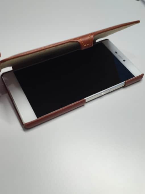 Stilgut Book Type in Cognac mit Clip stilgut Unter der Lupe: Smartphone-Hüllen von StilGut IMG 9648 e1445780815443 510x680